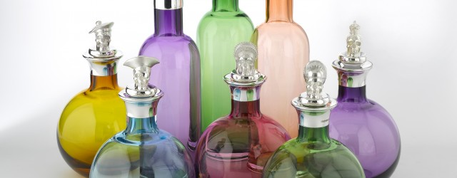 Theo Fennell coloured decanters and sterling silver skull toppers